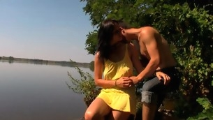 Outdoors legal age teenager sex happens by the large lake with a legal age teenager gut