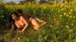 Lovely legal age teenager is procurement racy spooning session at the field