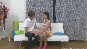 Sweet teen rides a cock on a white couch
