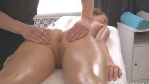Powered massage therapist makes sure a phat ass is oiled up
