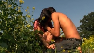 Wet and curvy brunette hair makes out with her stud in flower field